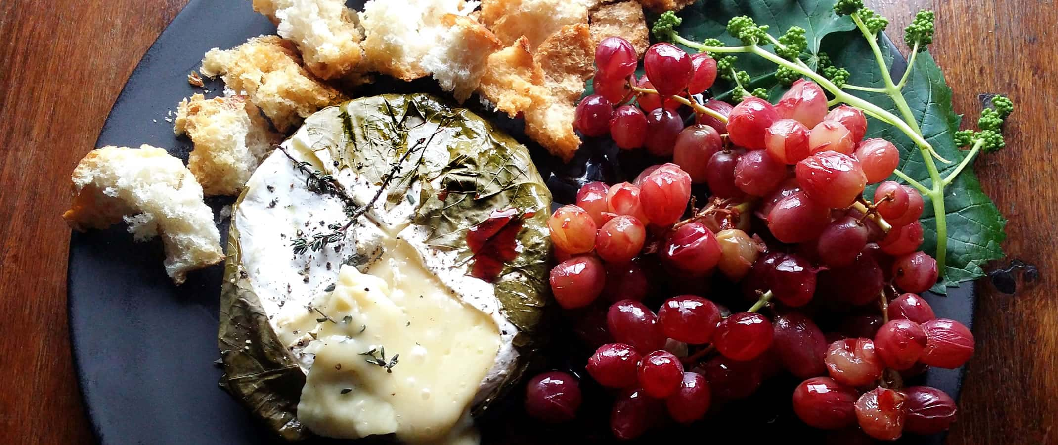 Camembert Roasted in Vine Leaves with Verjuice-Poached Grapes